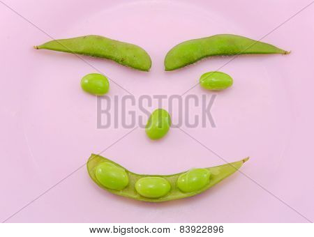 Green Soybeans In Pink Dish Isolate On White Background