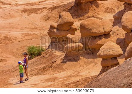 People Walk Among The Goblins Mushroon Shaped Hoodoos Goblin Valley State Park Rock Canyon Utah
