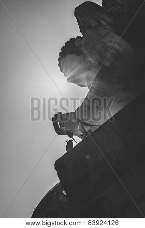 Buddha statue with the sun