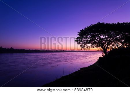 Beautiful Sunrise Out With Silhouetted Of Tree At Mekong River, Laos