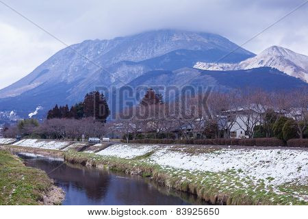 Small Village With Mountain And River