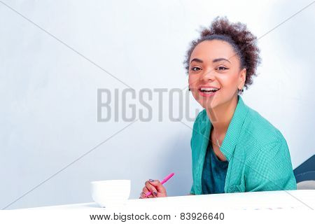 Young creative woman at brainstorming