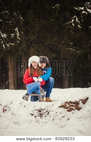 Couple Sitting In A Sled