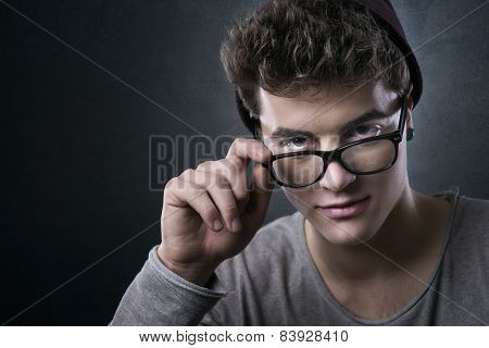Cool Young Man Adjusting His Glasses