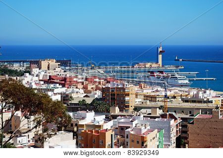 Almeria port and city rooftops.