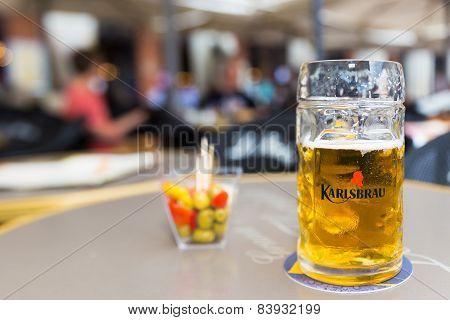 Pint Of Karlsbrau And Some Olives