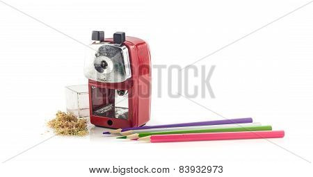 Old Mechanical Sharpener And Sharp Pencil On White