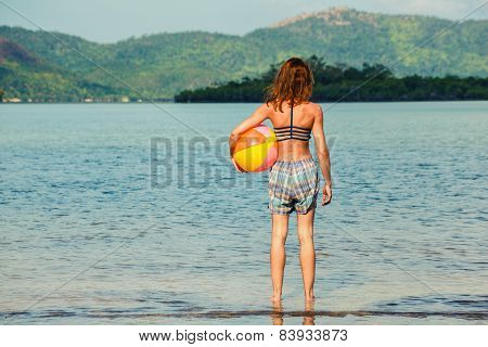 Woman With Beach Ball On The Beach