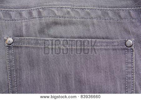 Close Up Of Back Pocket On Grey Jeans