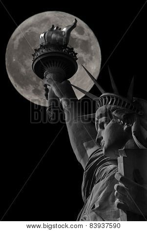 Statue of Liberty in the background full moon