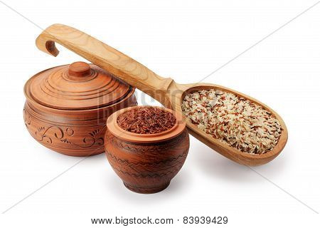Clay Pots, Wooden Spoon And Wild Rice