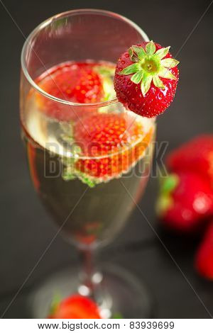 Starwberry Close Up Over Champagne Glass