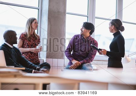 Team Young Professionals Having Casual Discussion