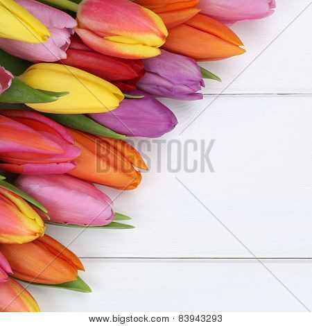 Tulips Flowers In Spring, Easter Or Mother's Day On Wooden Board