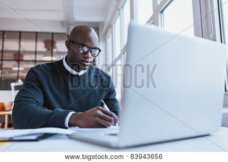 Handsome Young Businessman Writing Notes