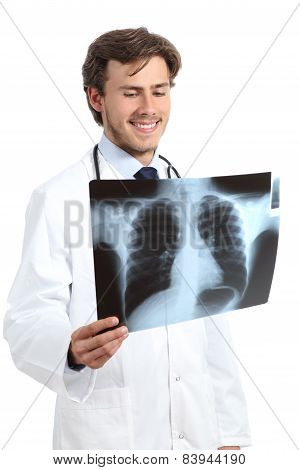 Happy Doctor Man Examining A Radiography