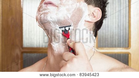 The Process Of Shaving The Face With A Razor