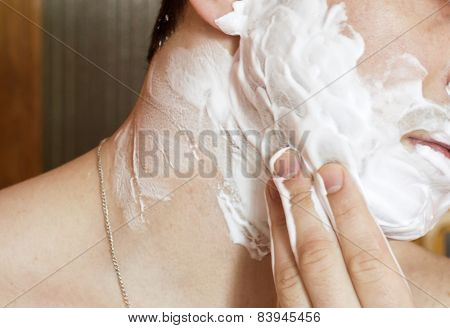 The Process Of Applying Shaving Foam On The Face