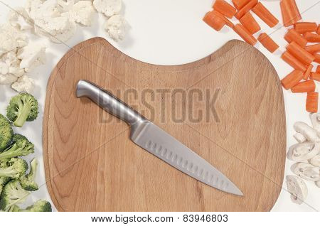 chopped up vegetables and a chopping board with a knife