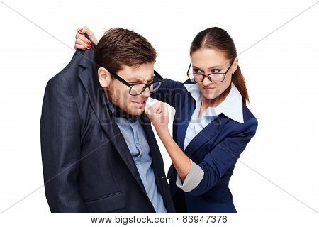 Strict female boss holding afraid businessman by collar
