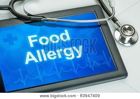 Tablet with the diagnosis food allergy on the display