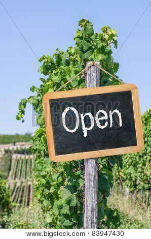 Open written on a blackboard in the vineyards