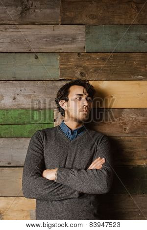 Handsome Young Business Man Against A Wooden Wall