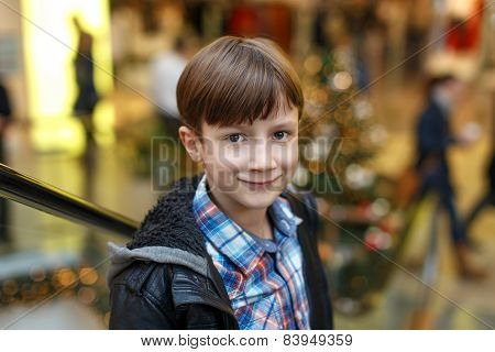 Little Boy In Mall On Escalator