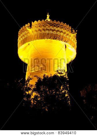Big golden prayer wheel at night