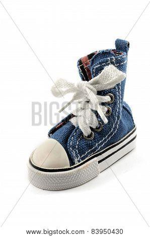 Tiny Denim Shoe On A White