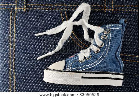 Tiny Blue Shoe On Denim Background