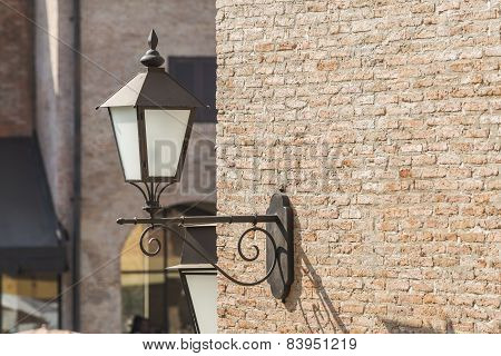 Old Lamp On The Brick Wall With Vintage Building Background