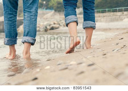 Close Up Couple Legs Image On The Surf Line
