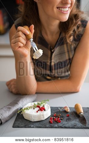 Closeup On Happy Young Woman Eating Camembert
