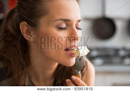 Portrait Of Young Woman Eating Camembert