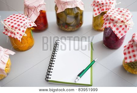 Notepad Among Jars Of Pickled Vegetables