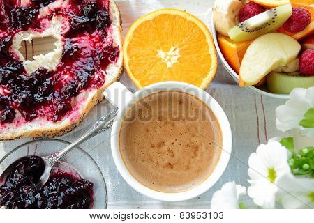 Coffee, bread with currant jam and fruits