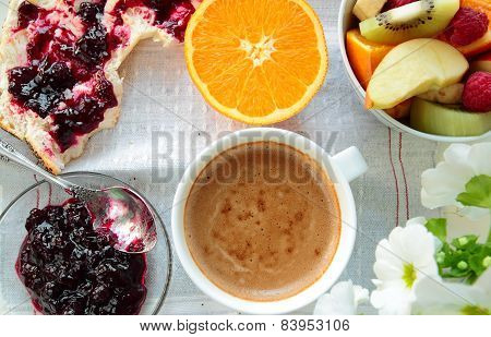 Bread with jam, fruits and coffee