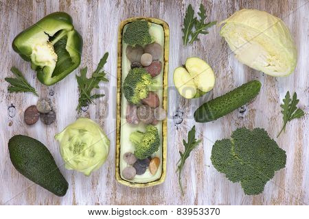 Set of fruits and vegetables on white painted wooden background.