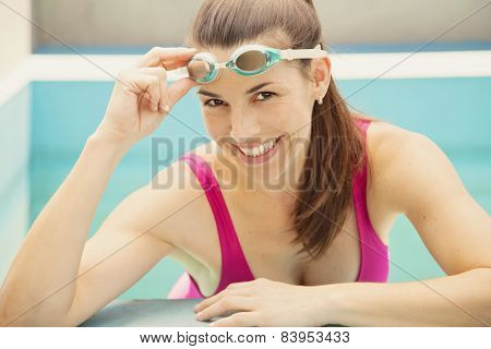 Happy woman in swimming pool