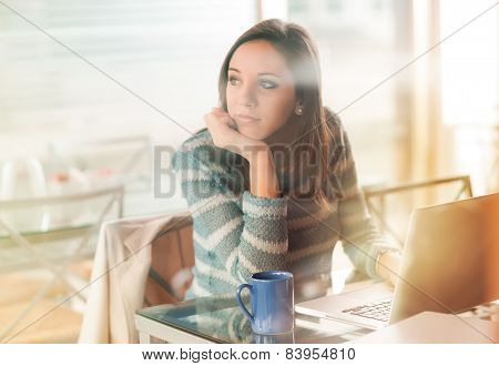 Pensive Woman With Laptop