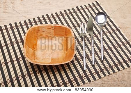 Bowl And Cutlery On The Table
