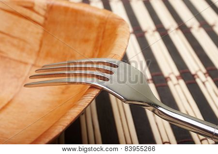 Fork Closeup In Bowl On Placemats