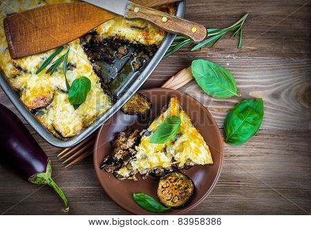 Greek Moussaka of eggplant and minced meat with olive oil.