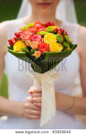 Beautiful bride on the wedding day, holding a bouquet