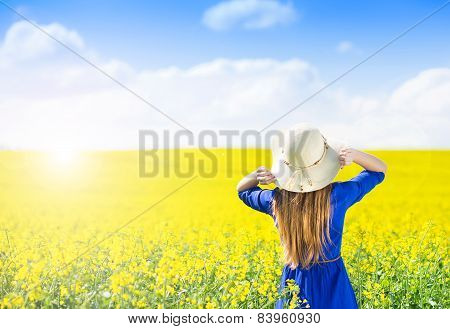 Woman in canola field