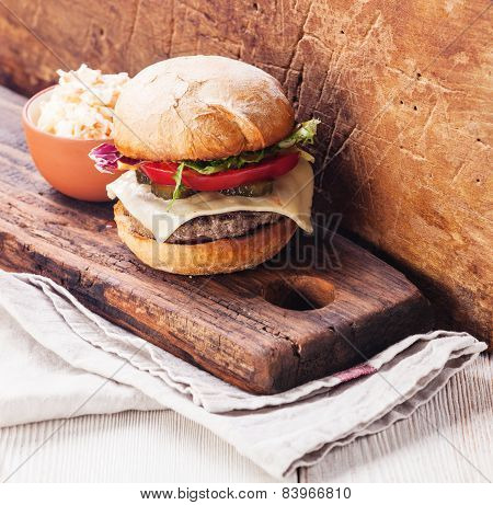 Burger With Coleslaw On Wooden Background
