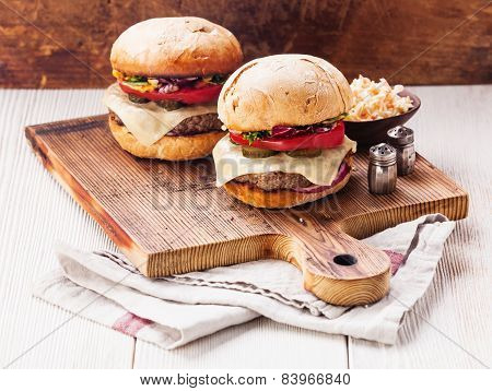 Burger With Meat And Coleslaw On Wooden Background