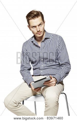 Thoughtful Man Holding A Tablet