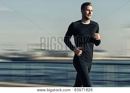 Athletic Handsome Man Running At The River Bridge